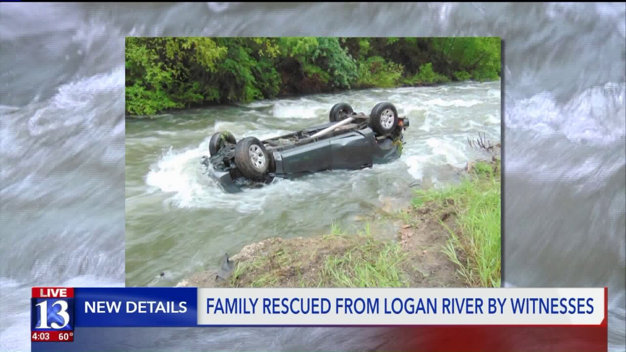 Family saved after rescuers pull them out of Logan River