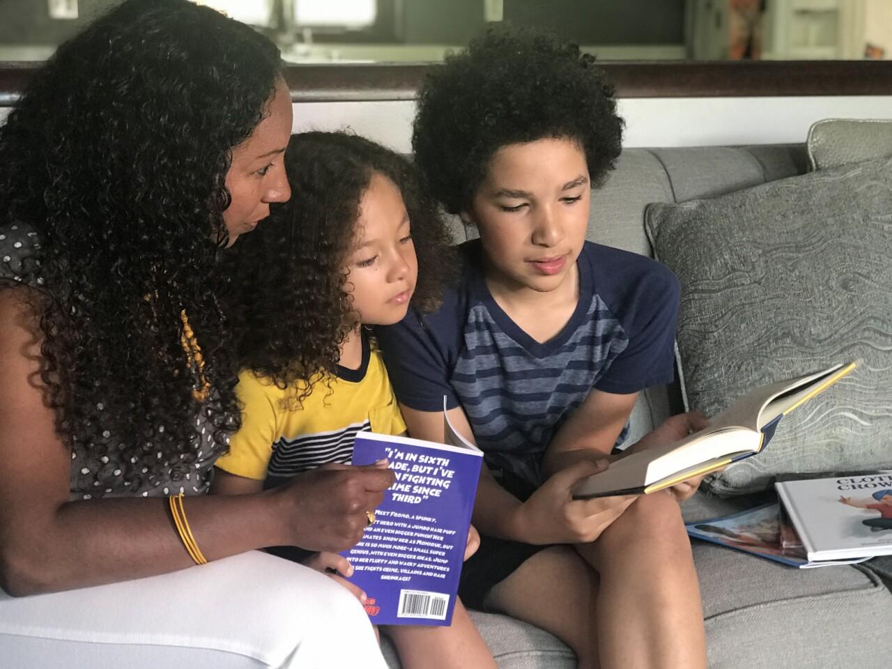 Deanna, Zion and Zephaniah reading