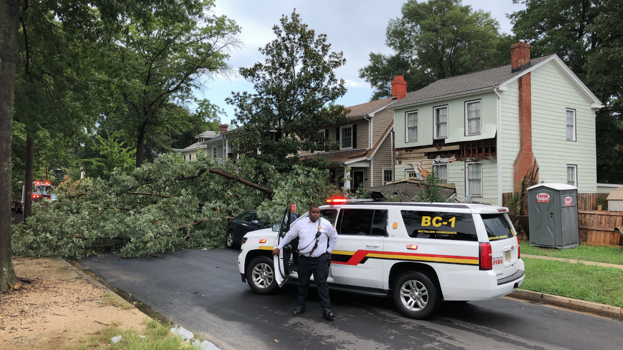 Storm topples tree on Richmond home,car