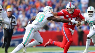 Josh Allen #17 of the Buffalo Bills runs the ball and blocks Sam Eguavoen #49 of the Miami Dolphins during the first quarter at New Era Field on October 20, 2019 in Orchard Park, New York.