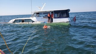 5 people and dog rescued by U.S. Coast guard after boat sinks in Saginaw Bay