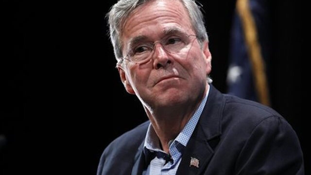 Bush tries can-do message as campaign competes for attention