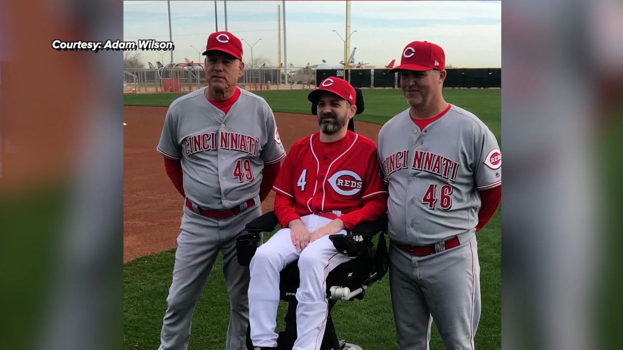 Adam Wilson with Reds players
