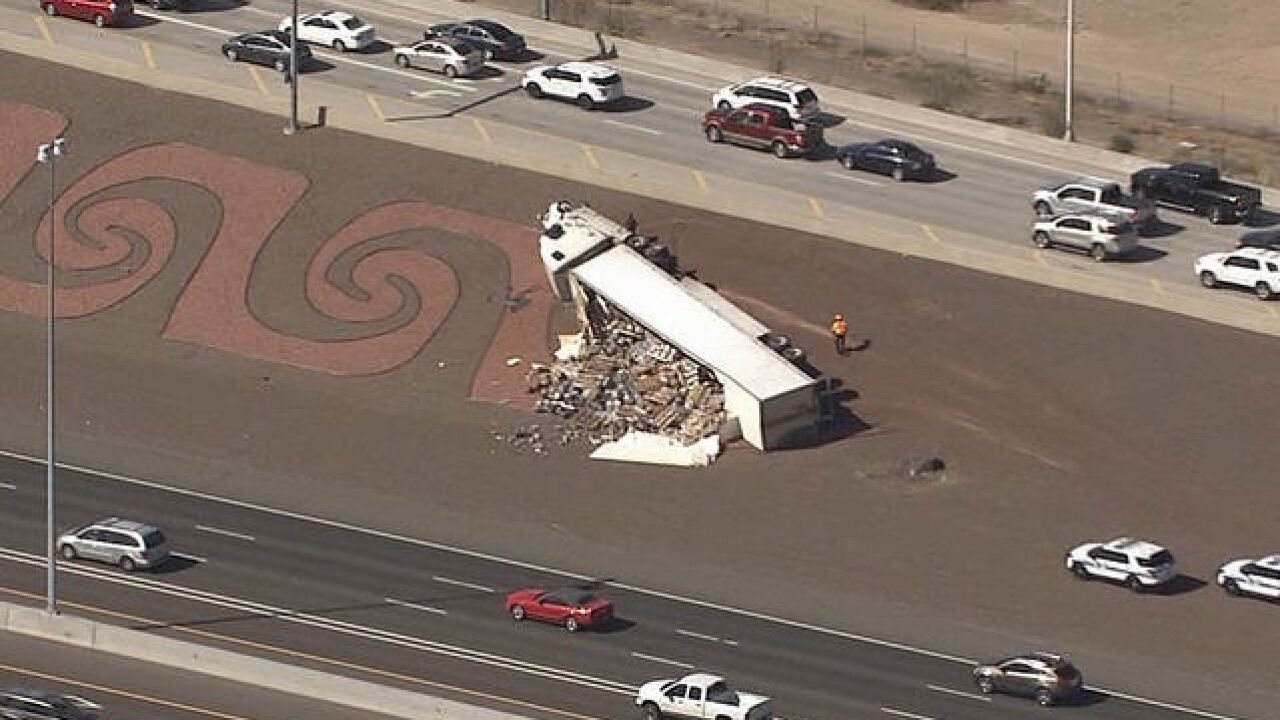 VIDEO: Truck carrying beer rolls over on I-17