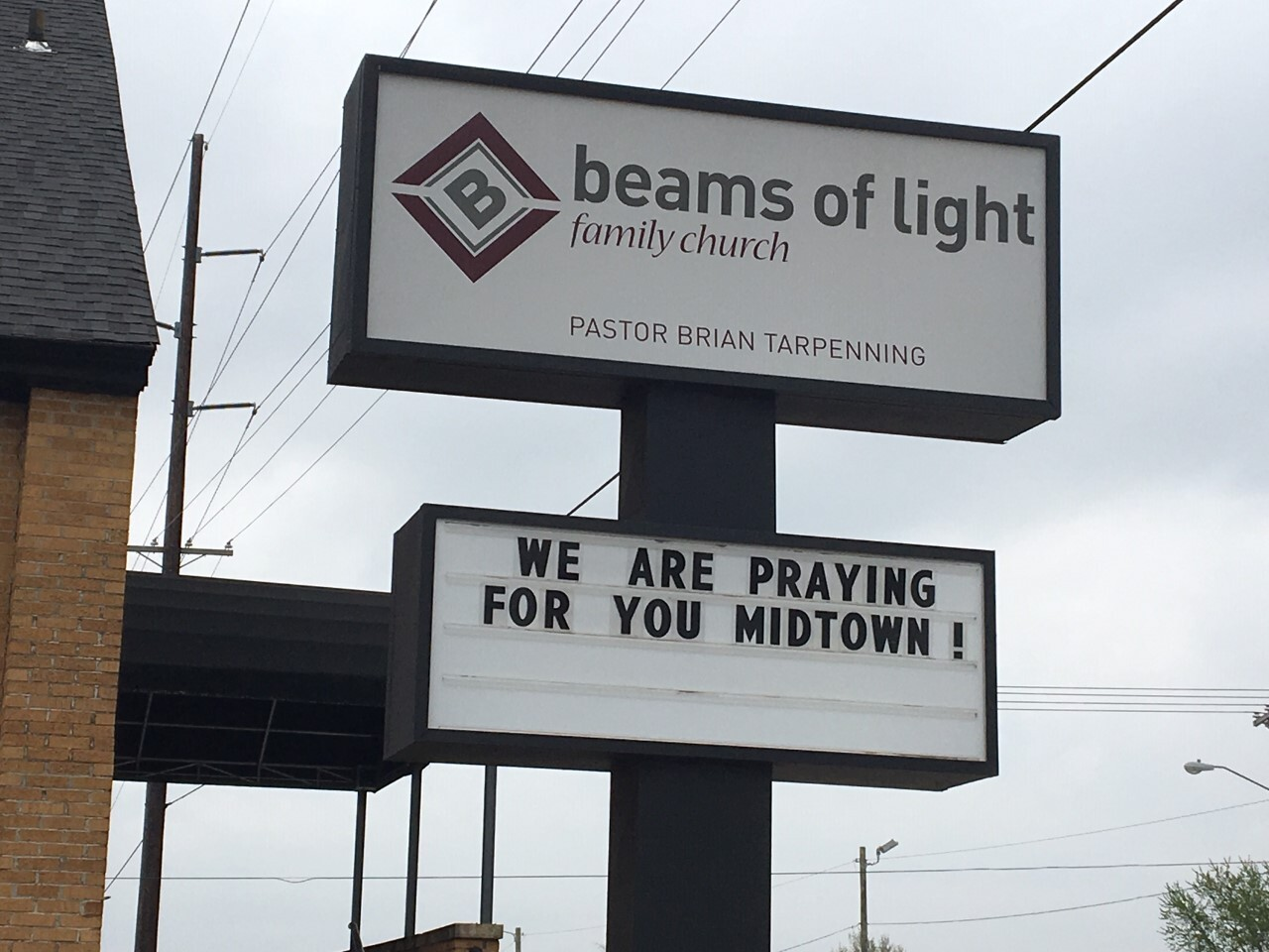 beams of light - We are praying for you midtown! sign