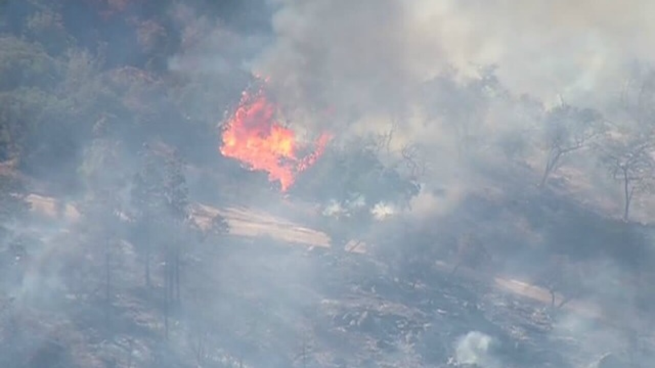 Crews respond to fire flare-up in Pala area