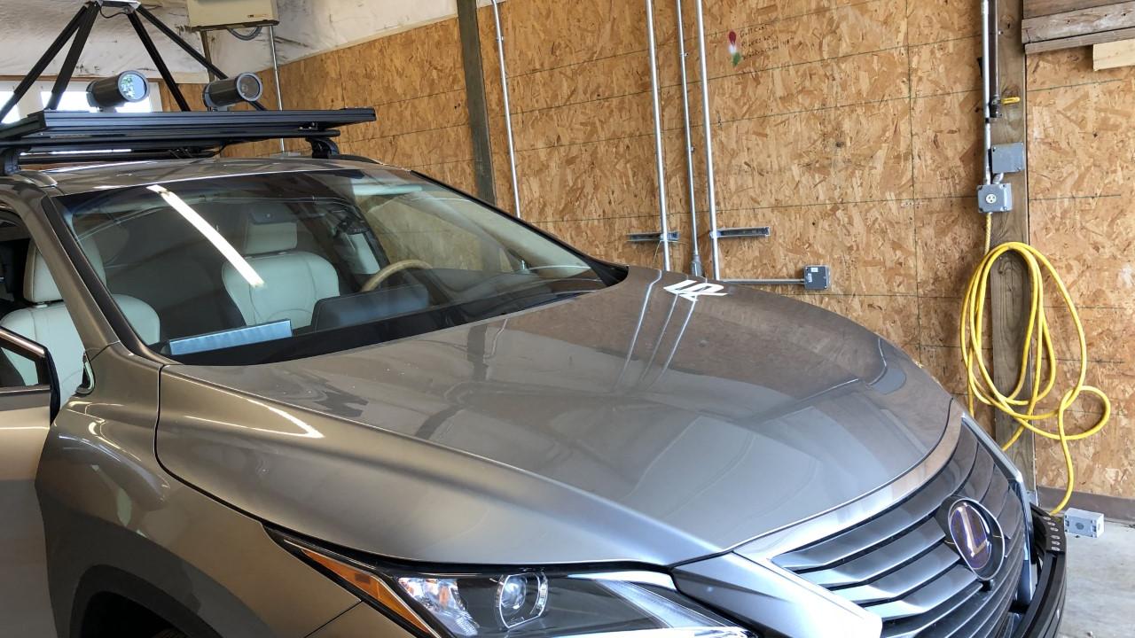 UC Autonomous Vehicle_ car in garage.png
