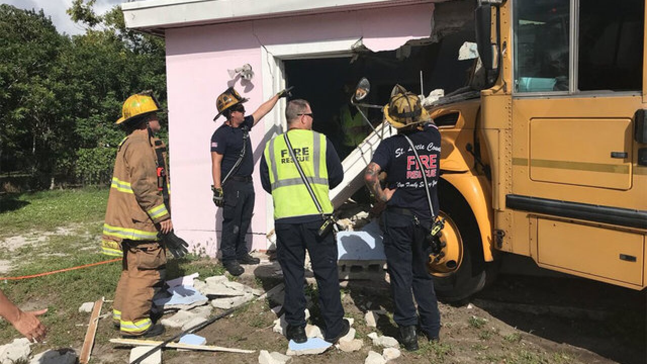Vehicle crash sends school bus into Fort Pierce house