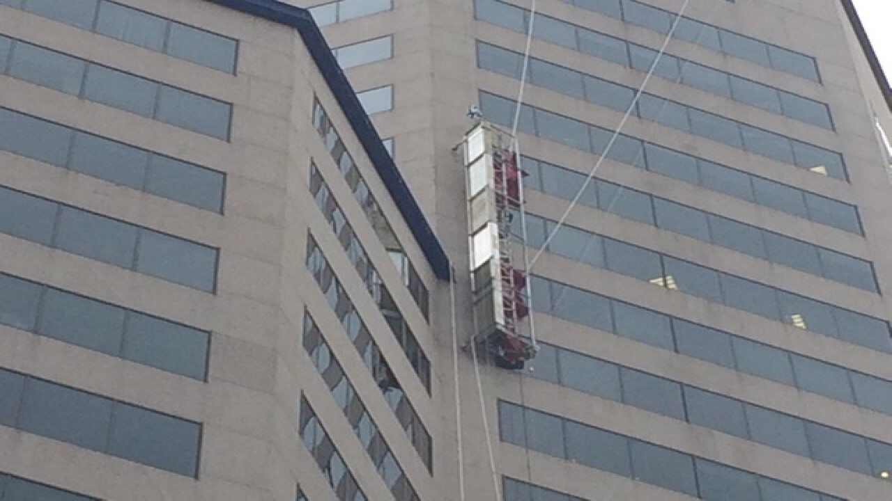 WATCH: Workers escape dangling platform Downtown