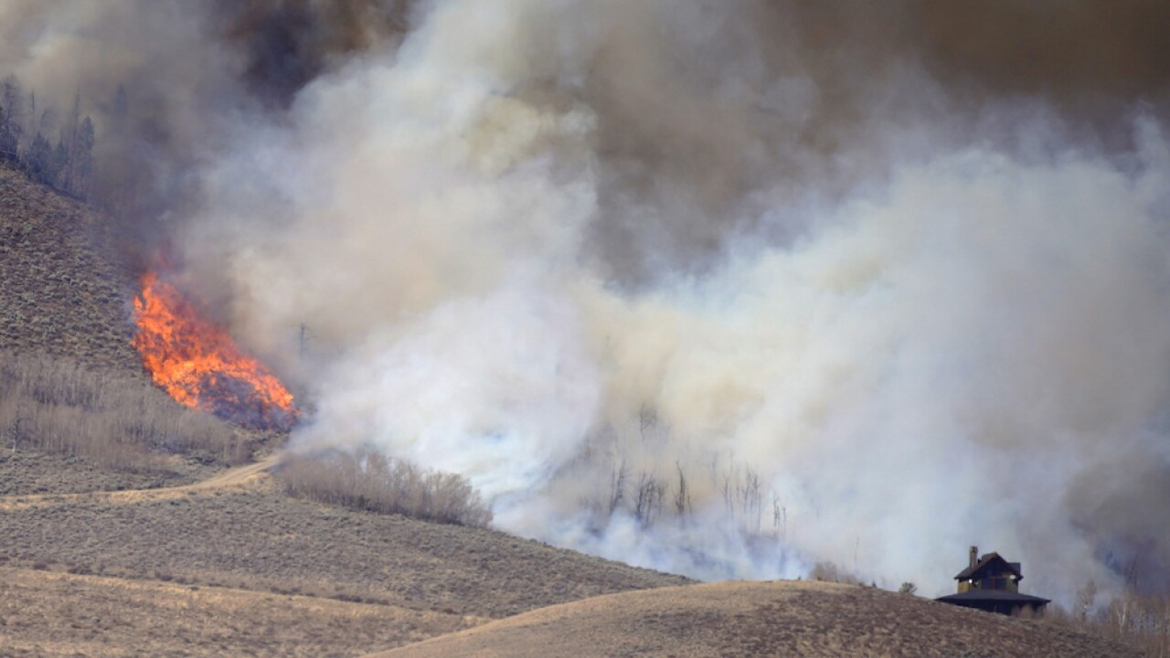 Colorado wildfires: Officials hope weekend snow will douse flames, but face gusty conditions Friday