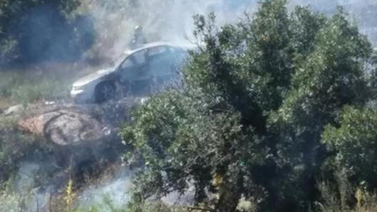 Deputies: Body found in burning car was homicide