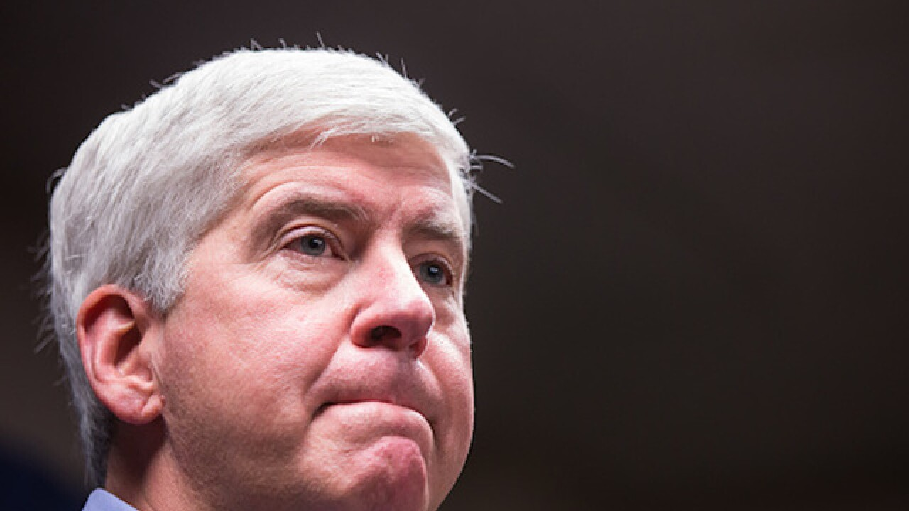 Mich. governor skips testimony in Flint case