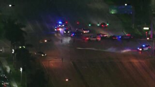 Aerial of police cars near Palm Beach Outlets