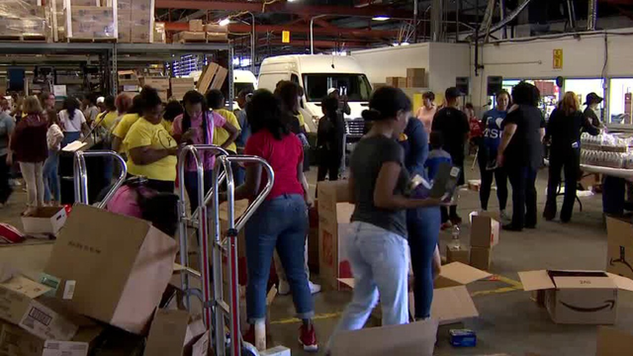 Volunteers Help Girls In Metro Schools