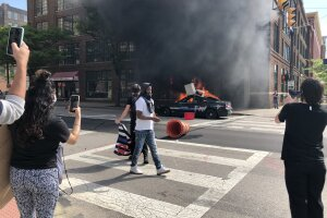 Two police cars set on fire in downtown Cleveland during protests.