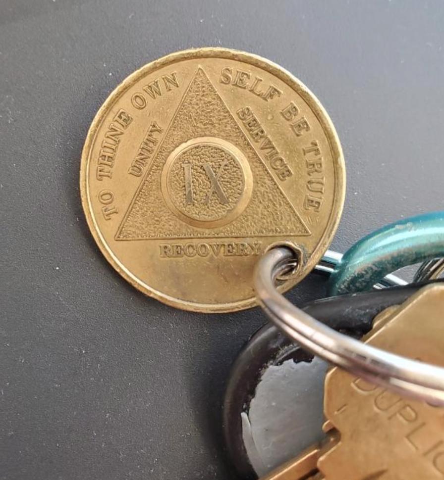 Travis' 9-year sobriety coin