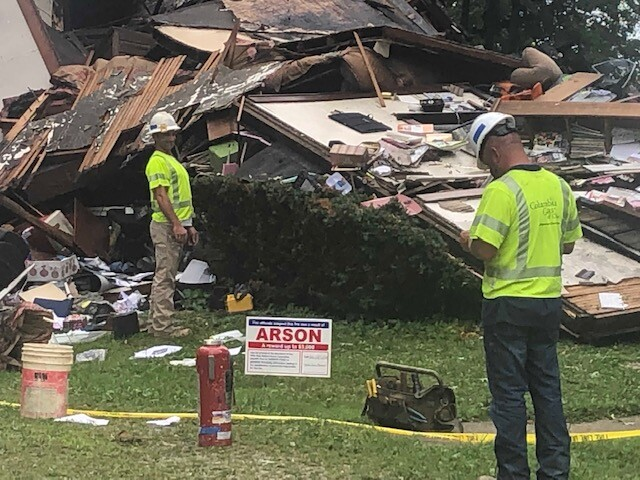 House explosion arson sign