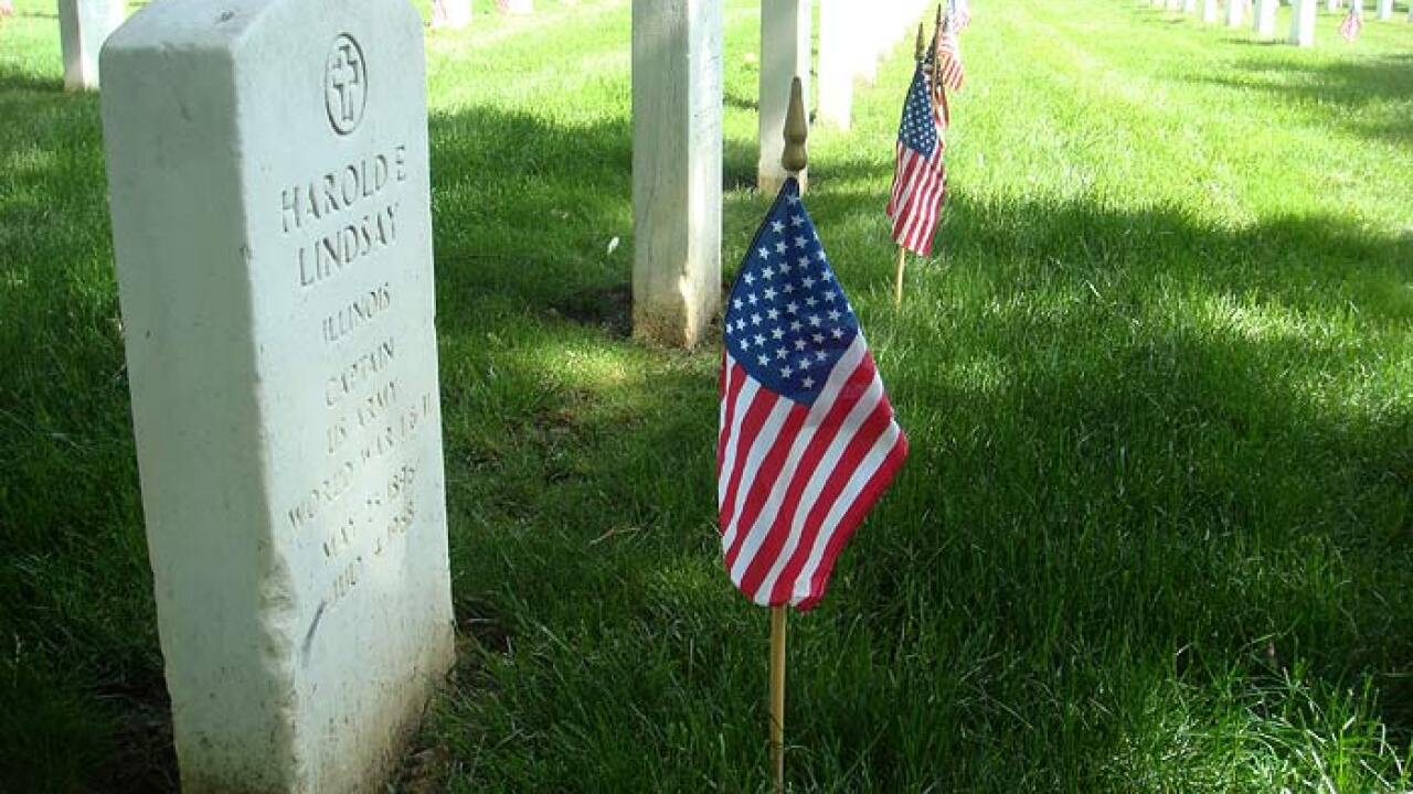 Soldiers place thousands of flags at Arlington graves ahead of Memorial Day