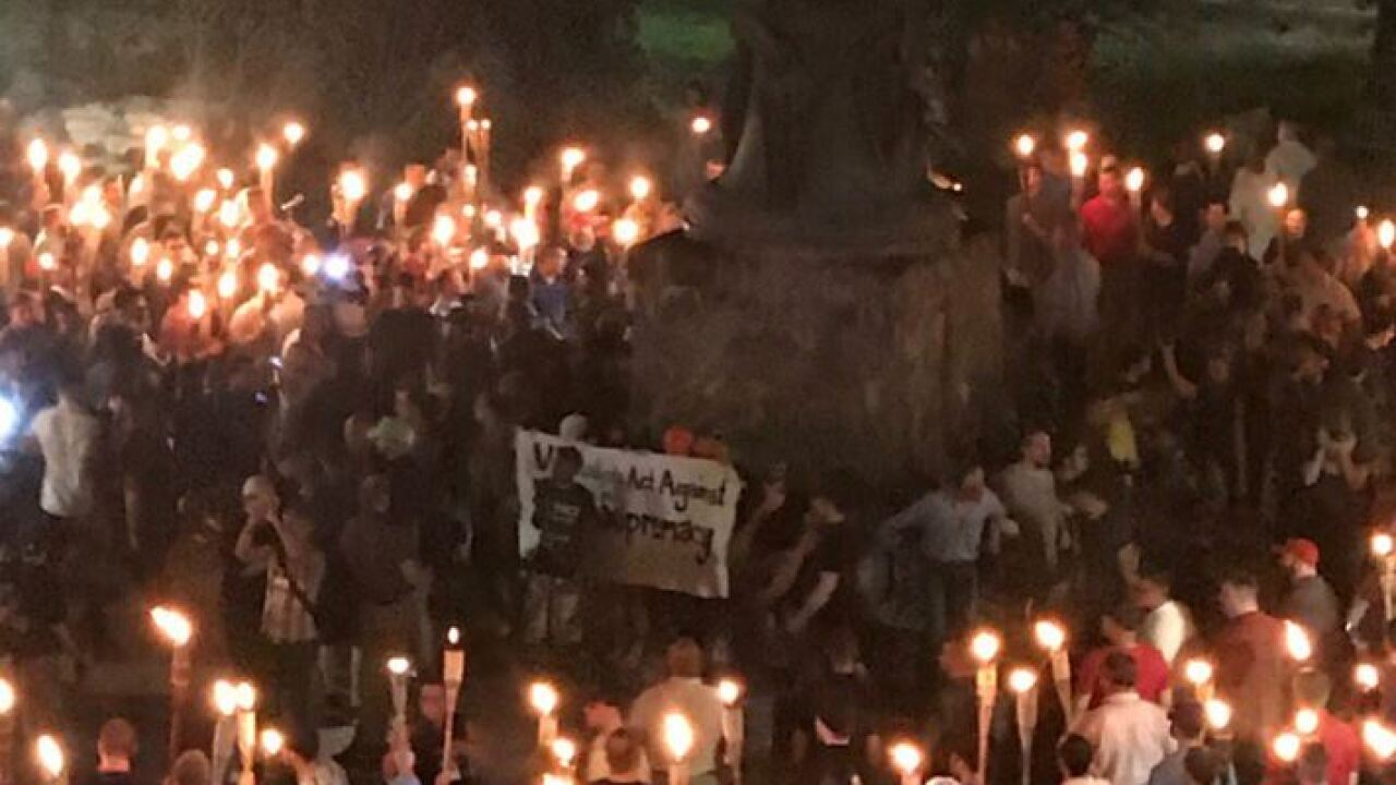 Marchers and protesters clash at 'Unite the Right' torch rally atUVA