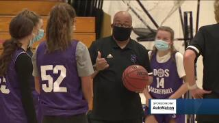 Denver South basketball coach faces death, returns to court