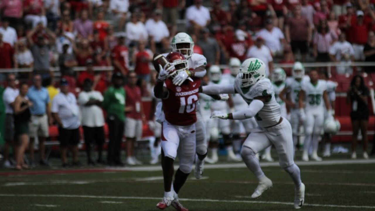 Pics: Fine, UNT defeat Arkansas, 44-17