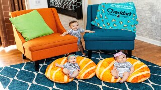 You can win adorable croissant-themed baby items from Cheddar's