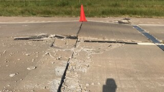WASH CO. ROAD BUCKLED.jpg