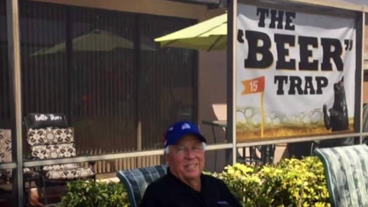 Larry Murphy sits behind the 'Beer' Trap sign