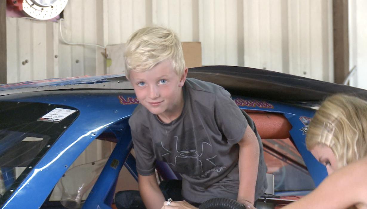 Renton Sokoloski climbs into the race car