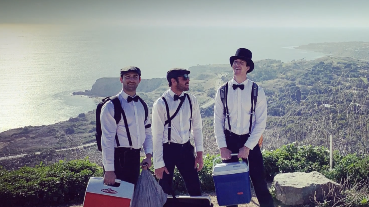 This well-dressed trio serves free drinks on hiking trails, bringing joy to hikers
