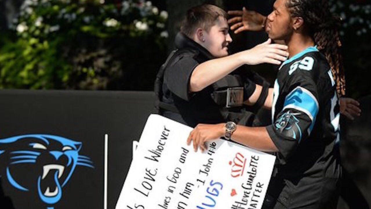 Charlotte tries to return to normal, lifts curfew