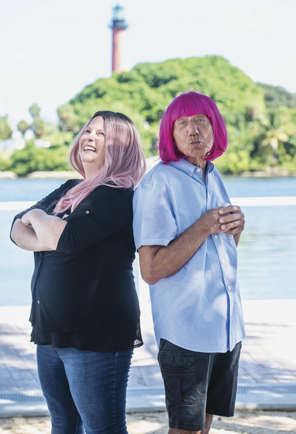 Liz Soulen and Joe Namath in pink wigs for Breast Cancer Awareness Month
