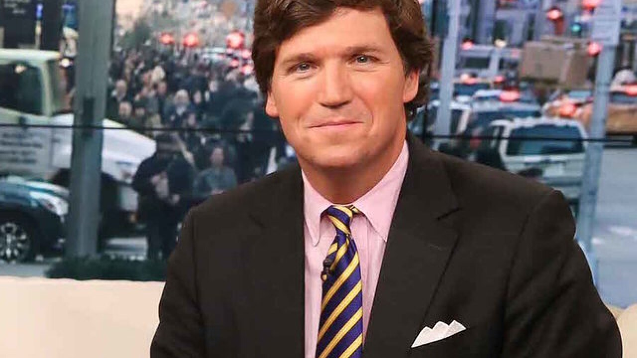 Protesters show up at home of Tucker Carlson, shout threats