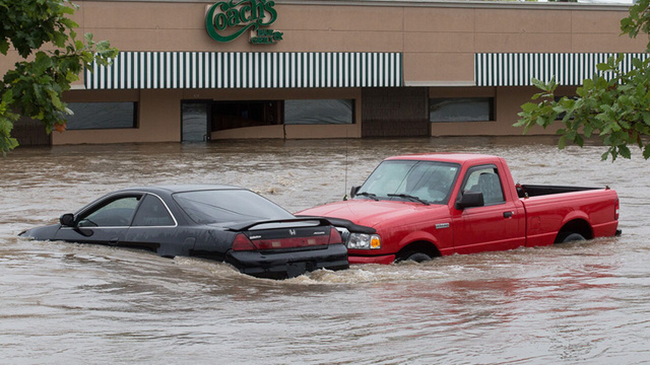 Businesses try to thrive 1 year after flooding