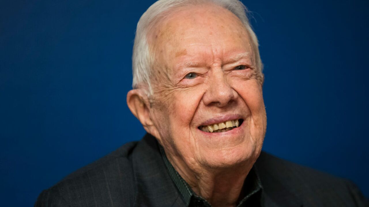 Jimmy Carter 'up and walking' after hospitalization, pastor says