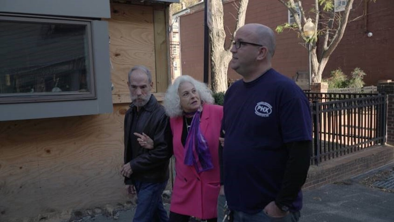 Joan and Gary walk with Mark Hemmis, owner of the Phoenix Emporium, and reminisce about the heroics of the first responders