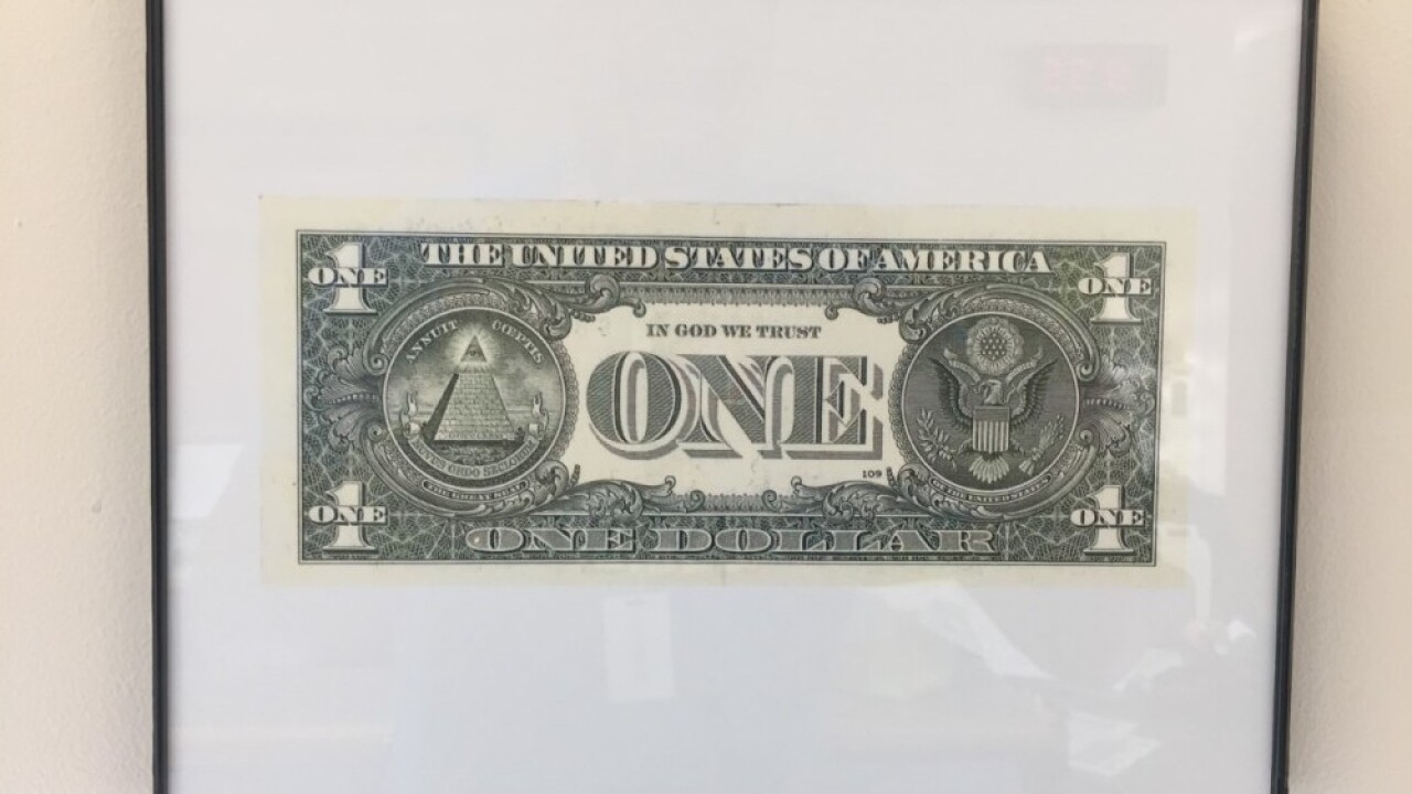 Kentucky school district complies with law requiring 'In God We Trust' display by hanging $1 bills