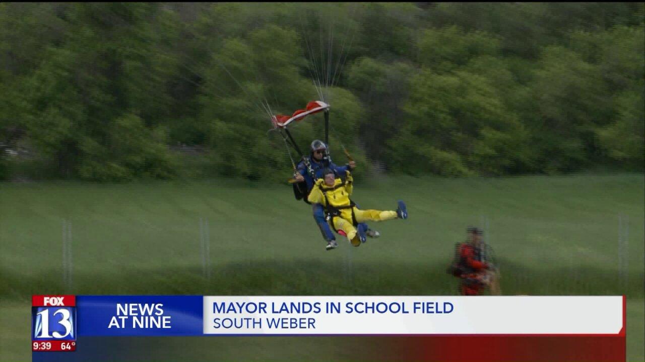 South Weber mayor skydives into elementary school's fieldday