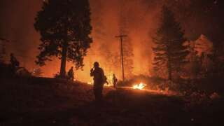 Wildfire that closed key California highway doubles in size