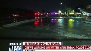 Crews working on water main break, roads closed