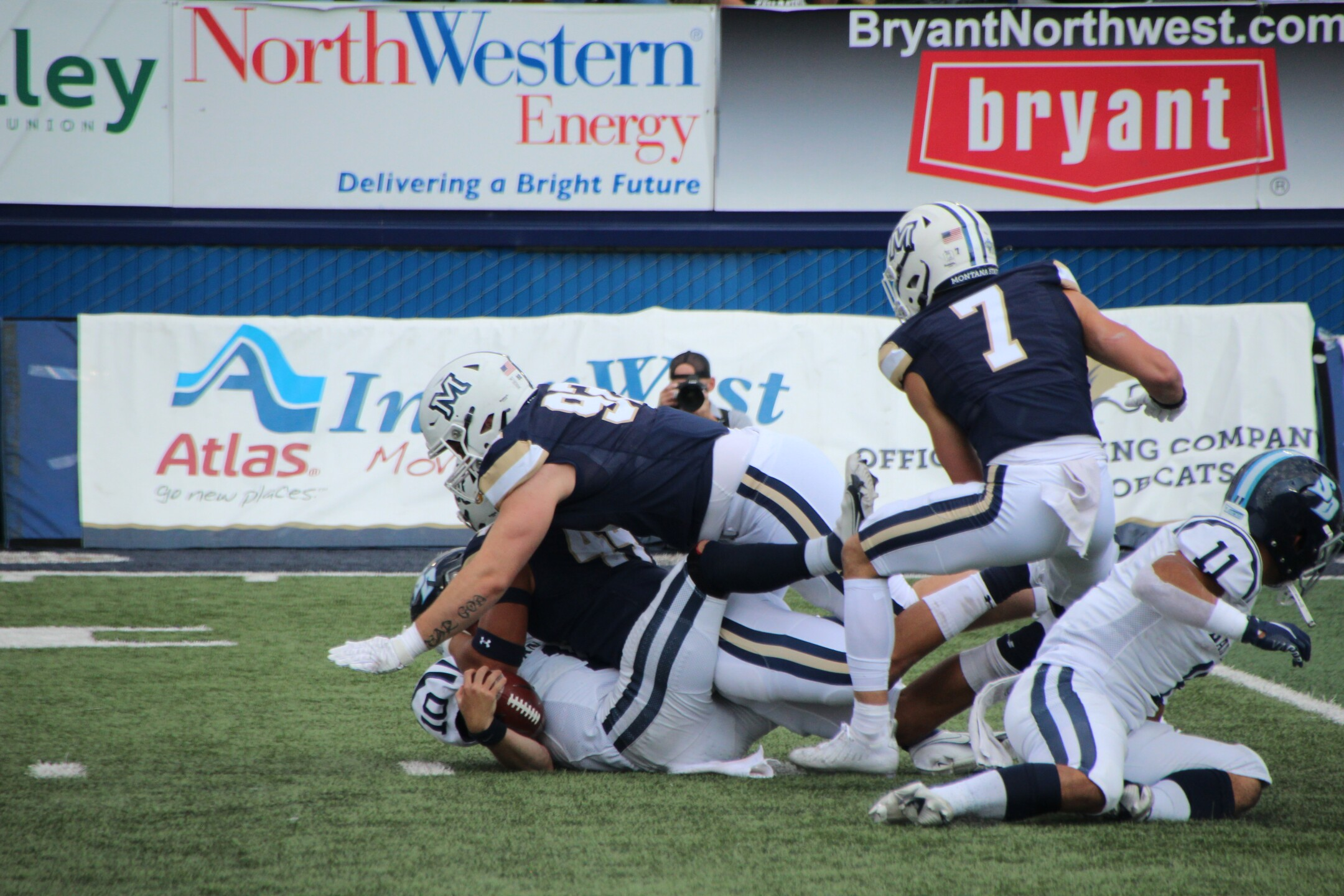 DE Daniel Hardy makes another sack in the first half