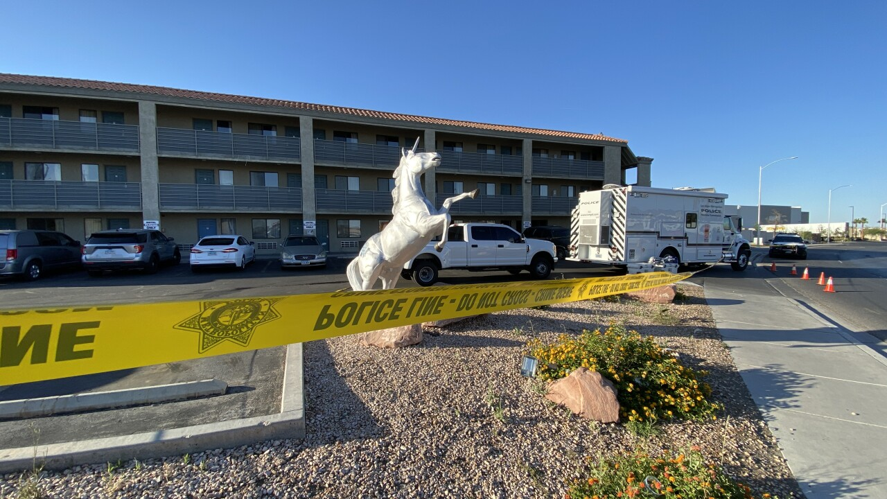 Las Vegas police process a scene near Blue Diamond Road and Interstate 15 on Thursday, May 27, 2021 after a nearly 30 hour hostage situation.