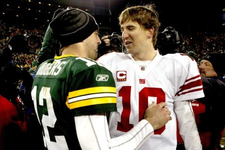 Green Bay QB Aaron Rodgers chats with Giants QB Eli Manning
