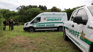 Crime scene vans near where body found in canal in Indian River County, July 23, 2021