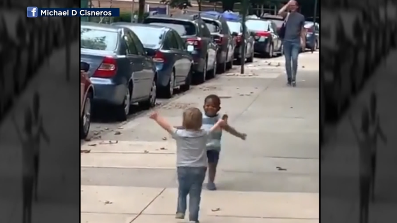 Internet falls in love with video of two toddlers running to hug each other