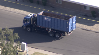 2 people trapped in truck with active power lines