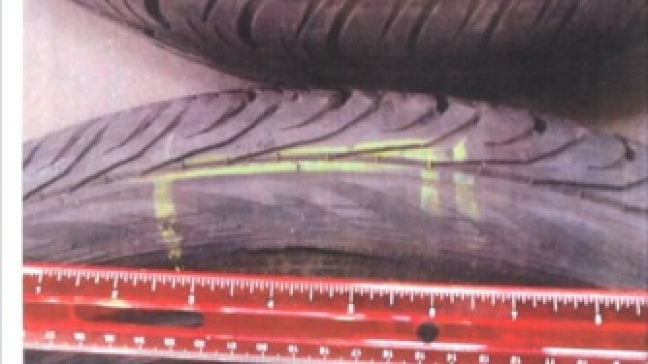 Parent charged for slashing coach's tires