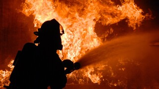 Firefighter putting out roaring fire