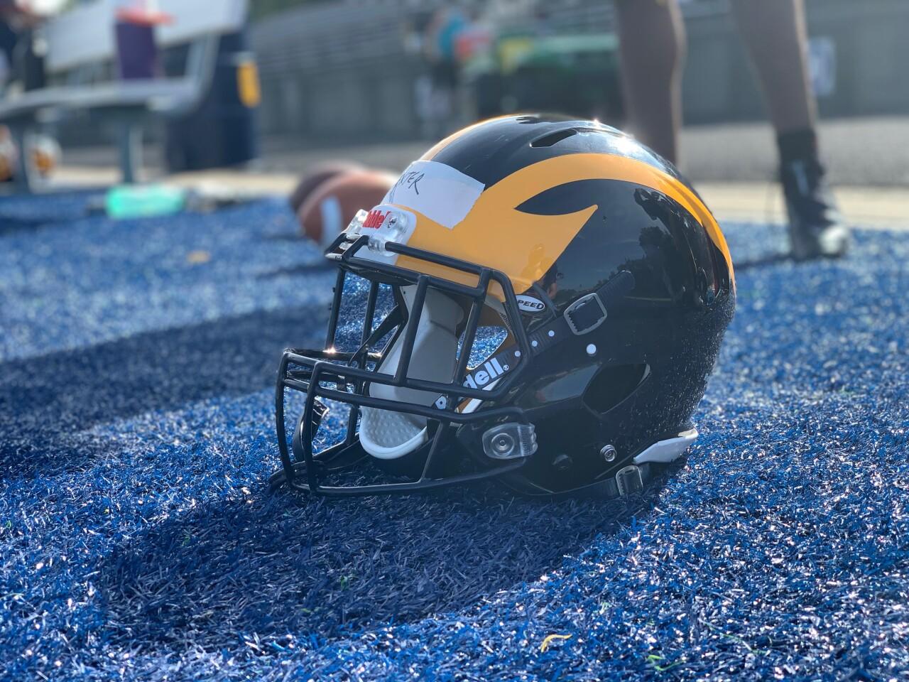 Godwin-Heights-Wolverines-varsity-football-practice-helmet-on-sideline-September-11-2020.jpg