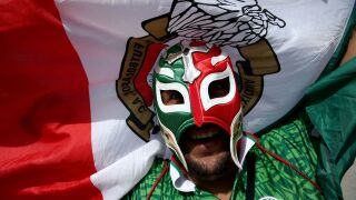 Mexico keeps World Cup ball rolling, downing South Korea 2-1